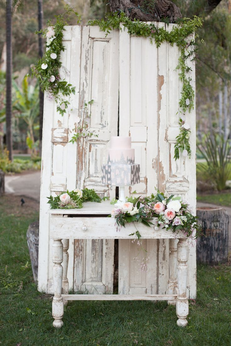 White-washed Door & Table for Cake - Great Backdrop.  See more wedding inspiration from Carly Rae Weddings CarlyRaeDesign.com on #smp here: http://www.StyleMePretty.com/2014/04/15/garden-glamour-inspiration-shoot/ #smp - Photography: DianaMcGregor.com - Cake: SweetAndSaucyshop.com
