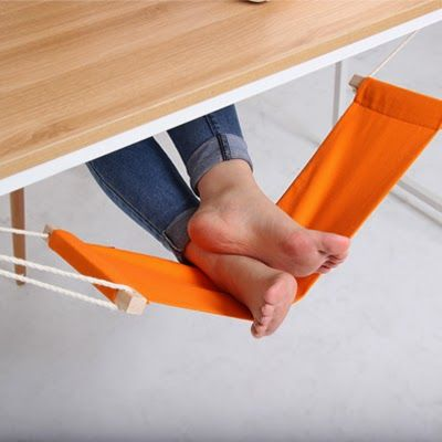 compact hammock for your feet that hangs under your desk and raises or lowers to put you in a working or slacking mood as needed. Best. Office. Upgrade. Ever. | via Gizmodo.com