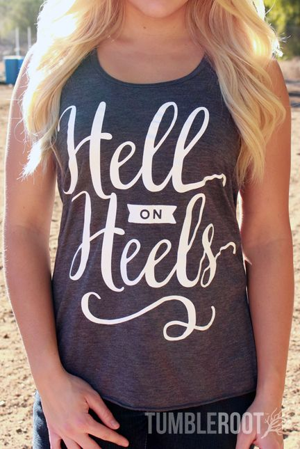 """Adorable country girl racerback tank top """"Hell on Heels"""" the perfect country concert tank top. Brandi is 5'2 and wearing a size Small."""