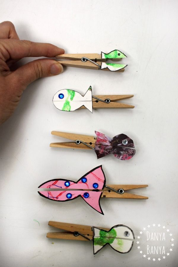Fish pegs, made from upcycled kids art, that nibble fingers