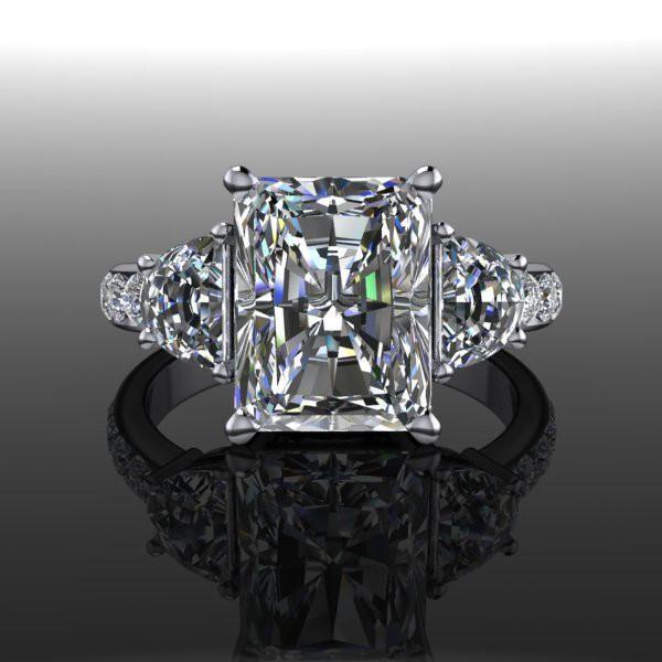 Forever Brilliant Moissanite Three Stone Engagement Ring 4.16 CTW from Bel Viaggio Designs.