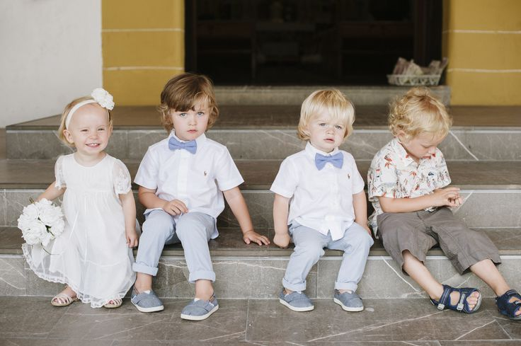 How super cute are the page boys ad flower girl? The page boys wore Ralph Lauren shirts and Tommy Hilfiger trousers. The flower girl's dress...