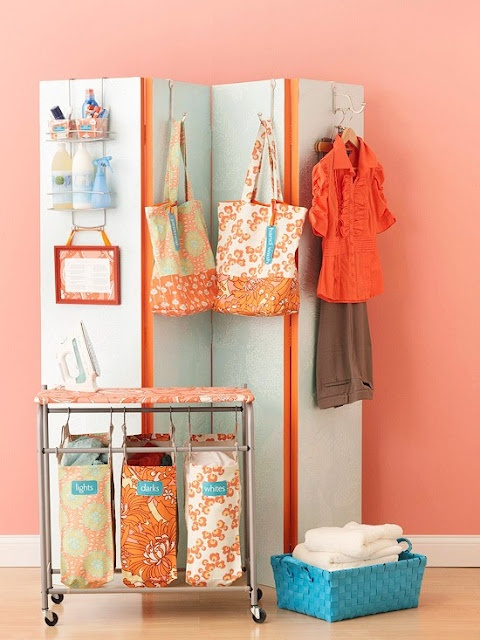 Create a Laundry Center    Simplify laundry day with a screen made from two sets of bifold doors hinged together. Dress up the doors with paint and wallpaper, then use hooks and an over-the-door caddy to store cleaning essentials. Add a framed stain-removal chart for handy reference. Dress up your frame with paint and a fabric-covered
