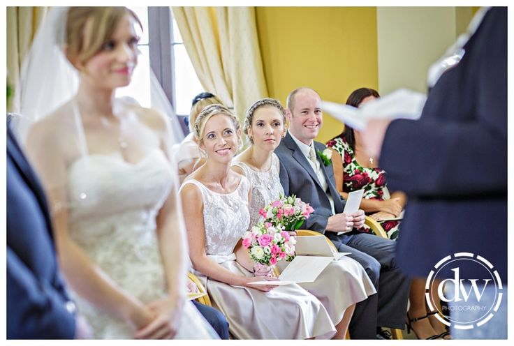The brides sister looks on during the wedding ceremony at Downing College, Cambridge
