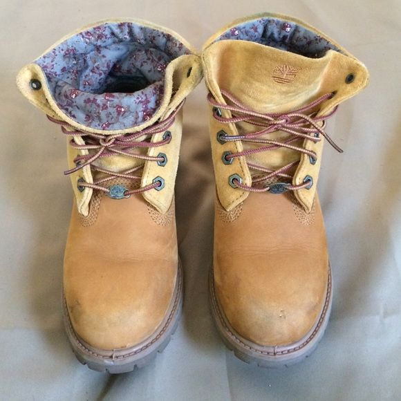 Timberland boots  The classic wheat timberland boot with a girlie twist . They can worn like classic sued timbs or folded down to show the girlie floral design on the inside. Size 7.5 slight crease is pictured. Could use a cleaning (I haven't tried) but other than that these babies are in MINT condition. Soles are perfect and bottoms are like new!! WILL ONLY TRADE FOR TIMBS SIZE 8. Will also accept reasonable  offers.  Timberland Shoes Combat & Moto Boots