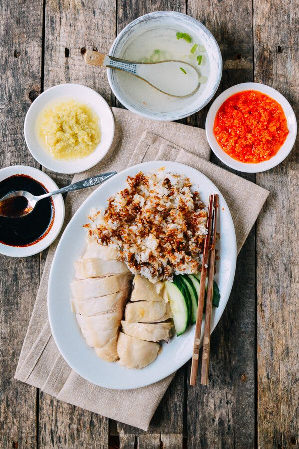 Hainanese Chicken Rice (Khao Man Gai): Hainan, Singapore, Malaysia & Thailand rice cooked in chicken stock with ginger and garlic and served with poached chicken breast.