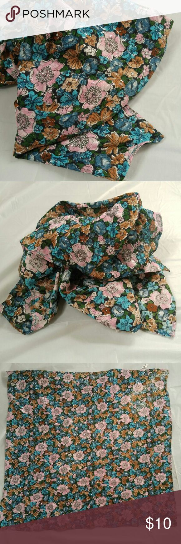 Vintage flower square scarf by Glentex pink silver This feminine scarf has an allover flower print in shades of pink, turquoise, green, brown, and navy blue with metallic silver threads woven throughout in a wavy pattern. The tag reads 80 % acetate  15% nylon 5% metallic by Glentex and care instructions. This scarf is in nice condition I could only find 2 pinholes where a brooch had been fastened, but this is only seen if you hold it up to the light and look up close, can't be seen when…