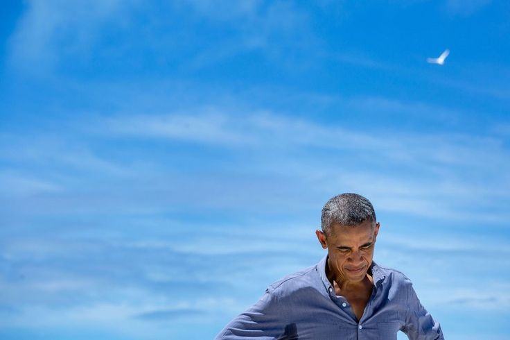 Obama pauses while talking with a writer from National Geographic during his Sept. 1 visit to Midway Atoll in the North Pacific Ocean.