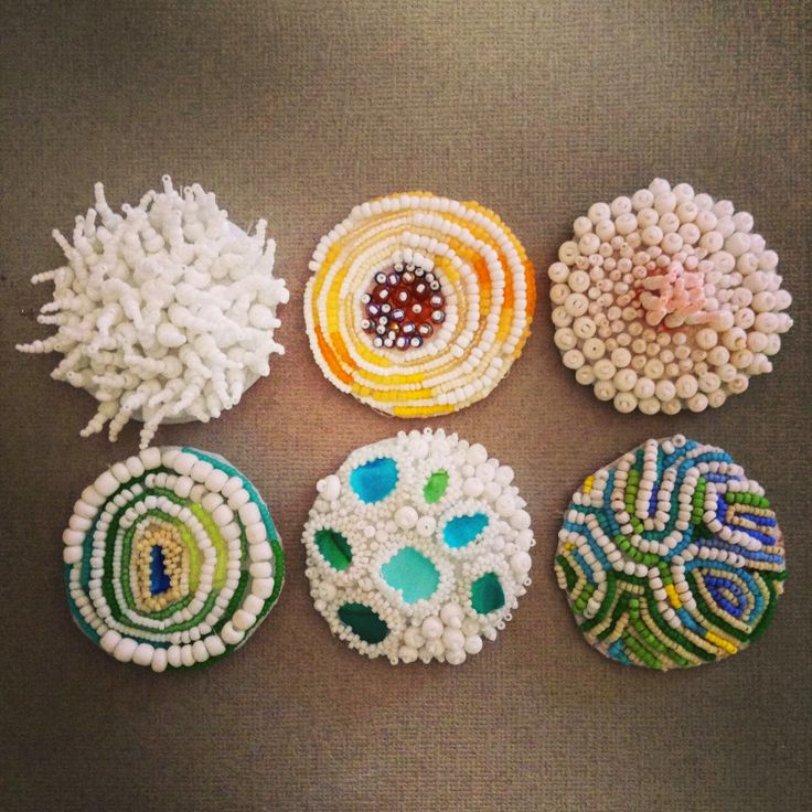 Eleanor Pigman - coral chorus.  Each piece is 2 inches in diameter.  Seed beads, felt, fabric and thread.