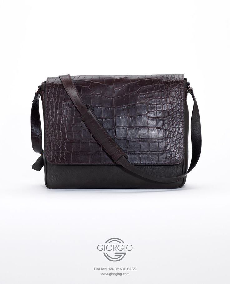 Hero, the leather shoulder bag for men. Hero is a messenger style bag of genuine Italian calfskin leather. The sealable flap bears a croco print pattern. The metal finishes are palladium, a rare metallic element of the platinum group.  #bag #luxury #shoulderbag #calfskin #leather #fashion #style #men #ideas #designer