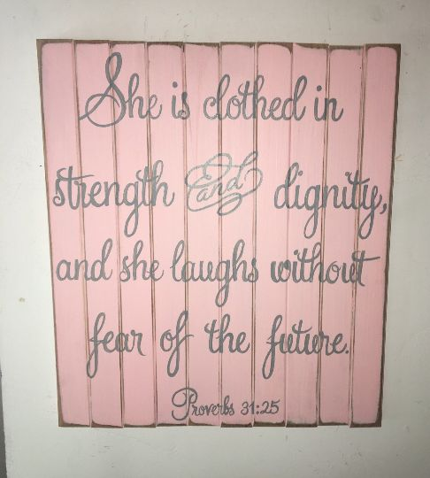 15 X 18 wooden sign: She is clothed in strength and dignity, and she laughs without fear of the future. Ballet Slipper Pink with Paris Grey script. No charge for custom colors.