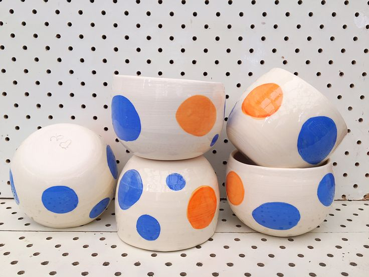 These Handthrown Earthenware Coffee bowls have been glazed with Blue Polka dots and one single Orange dot.They are clear glazed and then scaled with Liquid Quartz making them food safe.They hold approx. 250ml liquid.Please not that while all bowls are similar, each bowl has individual variations as is the joy of handmade objects.(Please see serving bowl and tumblers in this range also.Sold separately.)
