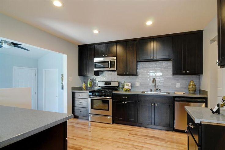 espresso cabinets and subway tile more kitchen cabinets designs