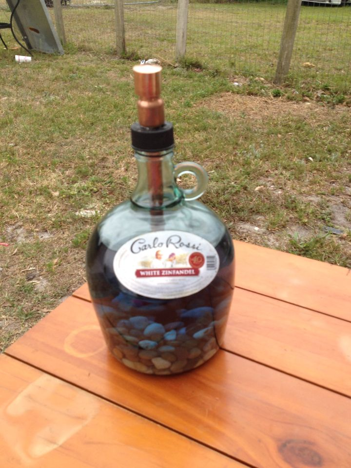 DIY citronella tiki torch using a gallon wine jug. Great for outdoor fun. Helps keep the mosquitos away.