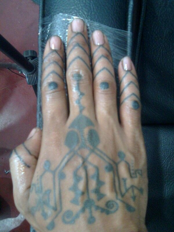 Handpoked myself with some additional tribal lines on fingers. Less is more.  Lloydoftherings 2013