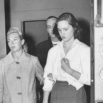 Lana Turner fetches her thirteen-year-old daughter Cheryl Crane from a downtown police station after the girl was found wandering on Skid Row. A year later Cheryl interceded in a heated row between her mother and Johnny Stompanato, stabbing the mobster in the stomach with a kitchen knife. A coroner's jury ruled the death a justifiable homicide. April, 1957. (Los Angeles Times)