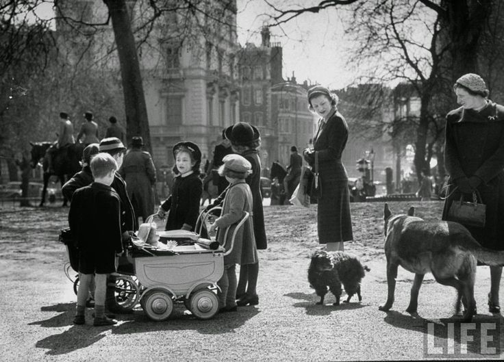 Children playing and people walking their dogs in Hyde Park 1951