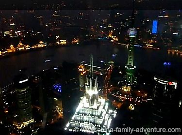 View from World Trade Financial Center. Modern Shanghai Skyline and the Oriental Pearl TV Tower. Views from the observation deck at the World Trade Financial Center.