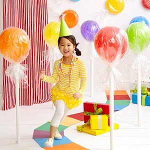 Balloon Lollipops.  wrap balloons in cellophane and attach to paper tube stick.