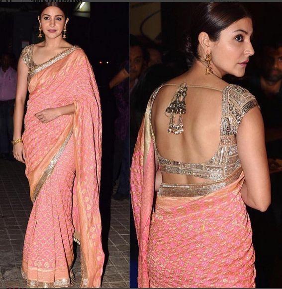 Anushka Sharma In A Pink Saree During The Dhanteras Puja.For this saree drop a mail at contact@ladyselection.com
