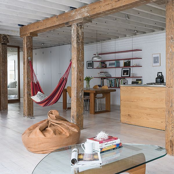 A hammock between two solid wooden beams would make a great accessoire in a treehouse