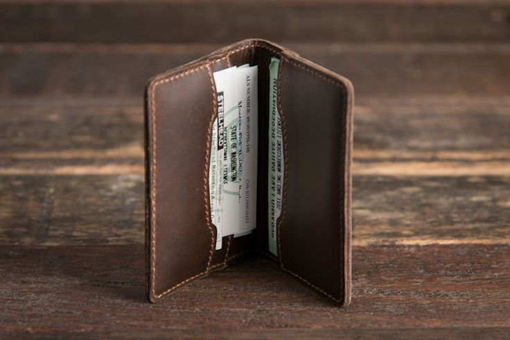 Our tough, rugged full grain leather wallet with pig skin lining has 3 sections to hold your fishing licenses (and hunting licenses), as well as your driver's license, concealed weapon permit and credit cards.  Our wallet is so tough you'll want to show it to your friends.  They'll envy you for it! - Open (Badger Brown)