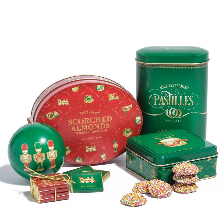 Collectible Christmas tins filled with delicious chocolate treats. #chocolate #gift #gifts #corporate #Haighs