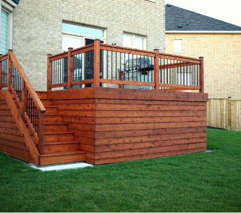 Cedar deck with horizontal skirting.