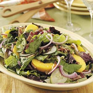 Tossed Salad with Peaches Recipe -Here's a colorful salad with a wide range of tastes and textures that go together so well. There are sweet peaches, tart lemon, tangy vinegars and all kinds of crunch from greens, bacon and nuts. —Denise Elder, Hanover, Ontario