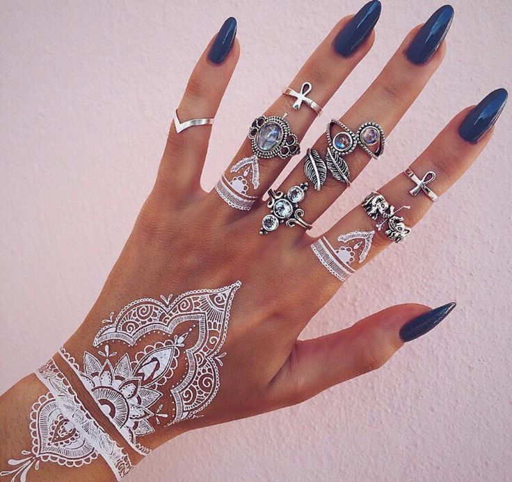 Our White Henna Hand Tattoos are becoming quite the rage globally. This sheet covers both hands and has rings and more bracelets to create a funky design. White tattoos come on blue paper,we highlight