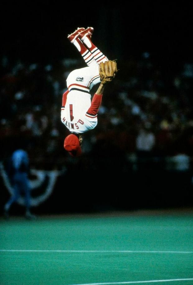 Photographer Ronald Modra perfectly captured the biggest names in sports, like this one of Cardinal's Ozzie Smith's signature backflip. See more stunning baseball photos with @mental_floss.