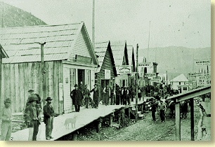 Here people walk on the Barkerville Sidewalks, heading to the River.
