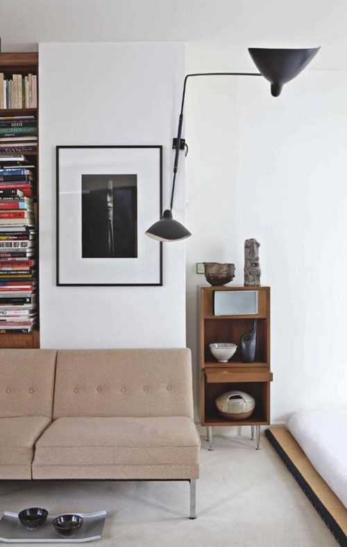 Serge Moullie wall lamp + simple framing + book shelf