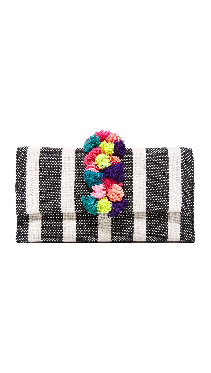 A cluster of multicolored pom-poms punctuates the front of this striped Loeffler Randall. Take it on a tropic vacay or out on the town.