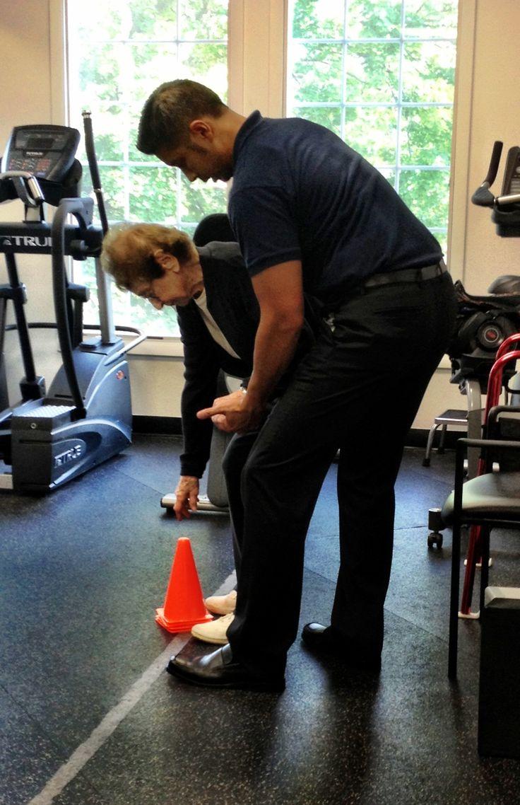 Dr. Karn Santikul performing balance exercises with a