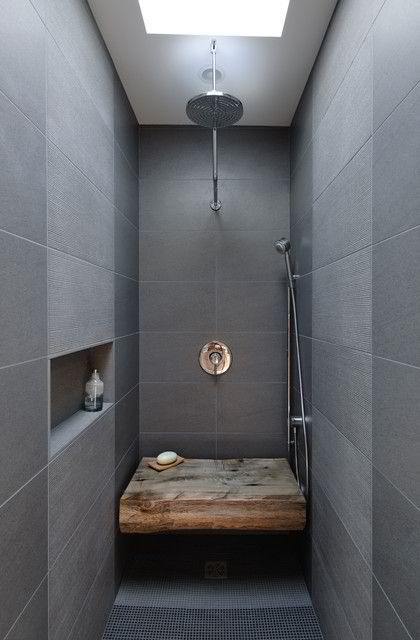I'm not sure how practical a piece of wood, such as this, is in a bathroom - but I love the look of it. Also, note the in-built shelf - a great way to incorporate space to place items in a small bathroom.