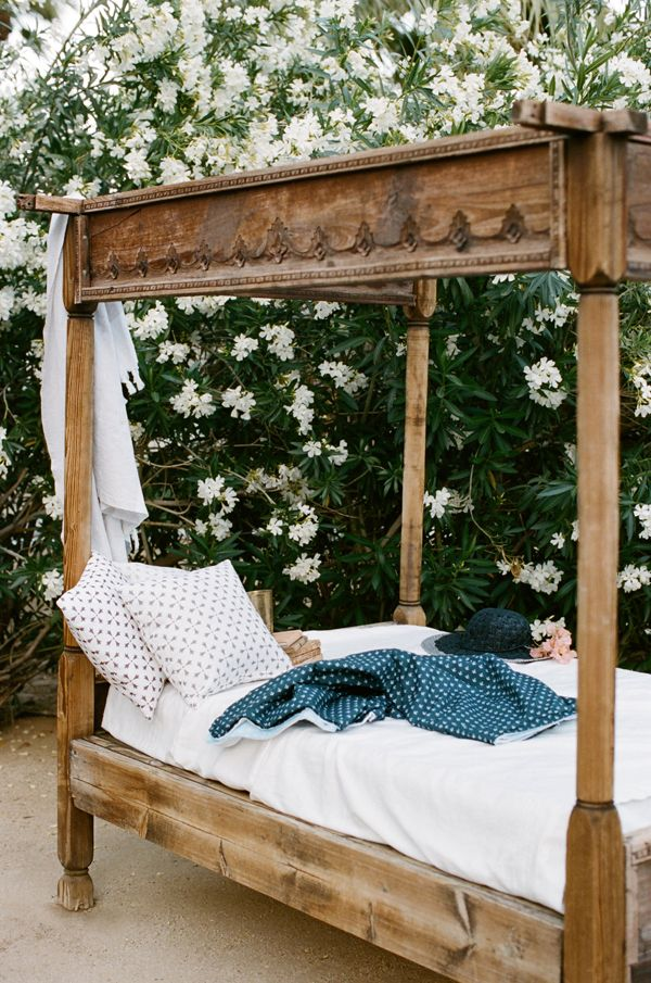 Outdoor four poster carved wood bed