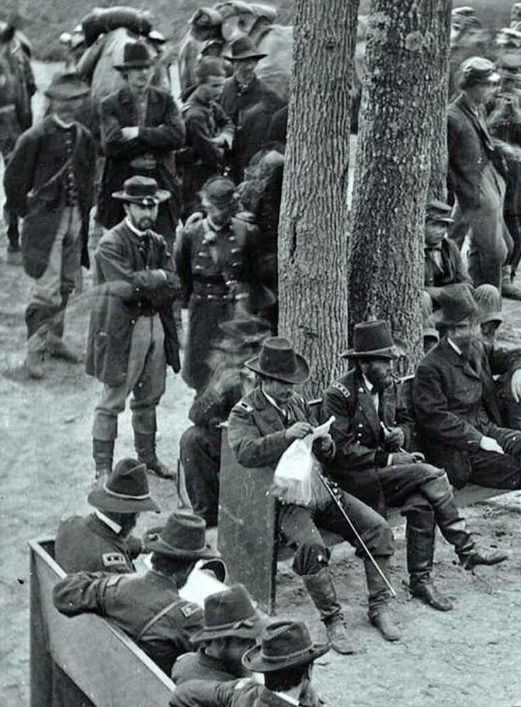 General Ulysses S. Grant (center of bench beside tree) on eve of Siege of Petersburg VA, 1864.  Photo by Timothy H. O'Sullivan.