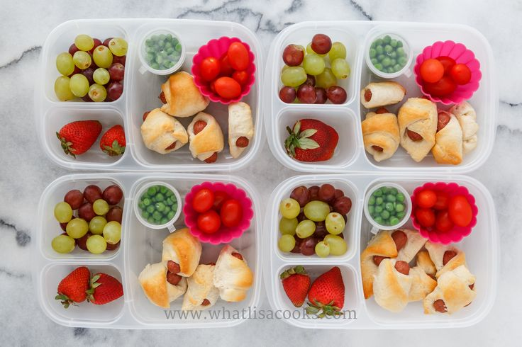 Pigs in a blanket, tomatoes, peas, grapes, strawberries. Packed in  Easy Lunchboxes .