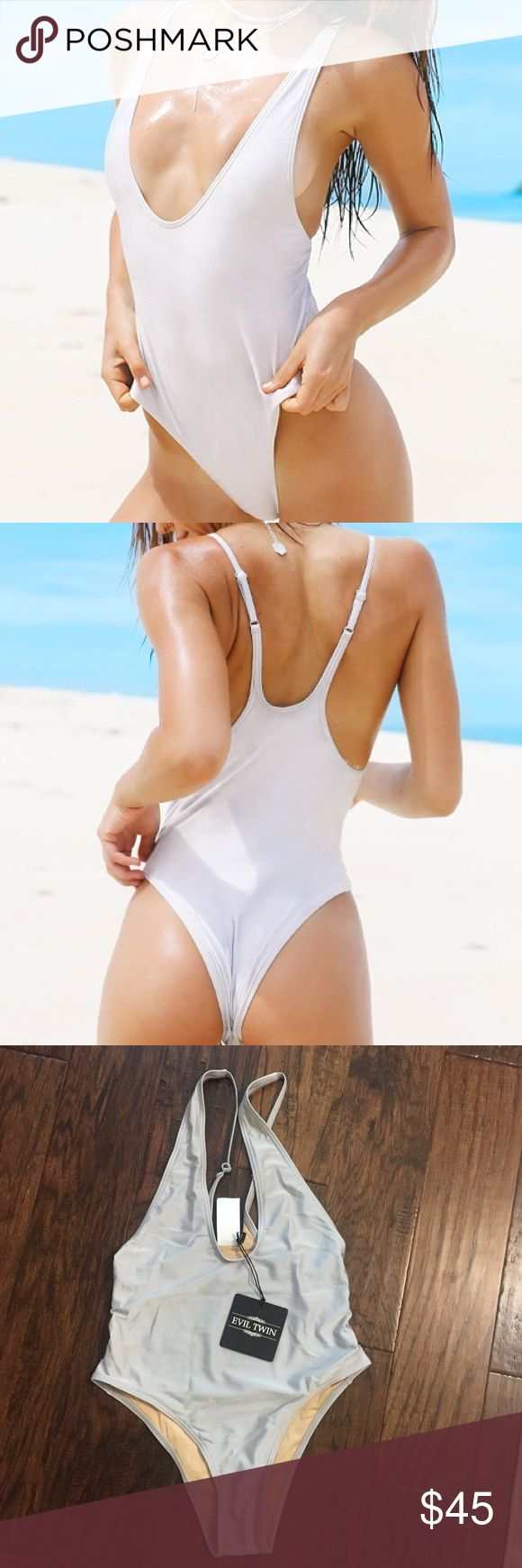 NWT Light grey/silver one piece swimsuit Size small (small US = 8 AUS)! Brand new with tags and hygienic liner. Bought it from Pepper Mayo. Originally $80! Super cute fit. The back has adjustable straps. Pepper Mayo Swim One Pieces