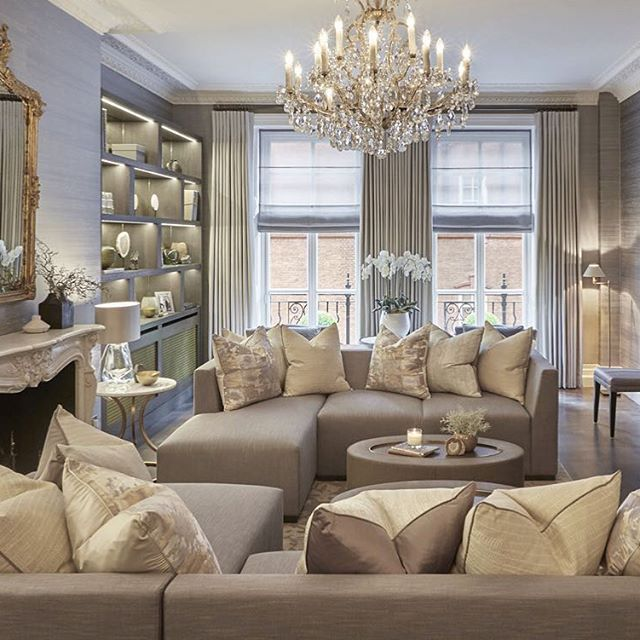 We combined luxury, comfort and practicality in this room with hard wearing fabric on the corner sofas and ottomans upholstered in faux shagreen it's the perfect place for our client's family to relax whilst the chandelier, silk wallpaper, touches of gold and luxurious cushions add some opulence to this grand room. Even I get room envy from this one! ✔️
