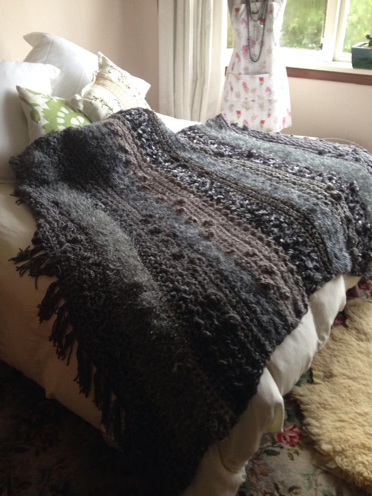 This crocheted throw consists of wool, cotton, silk, poly, glitter and fluffs.  Very textured and I use up to 4 different wools at the one time to get the look.  Use different stitches but mostly double crochet.  Size approx 170 x 150.
