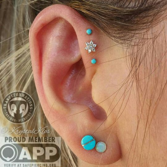 Triple forward helix Krystal did on a beautiful lady with fantastic taste in jewelry! The 14K gold star in the middle is by our very own Alchemy Adornment!