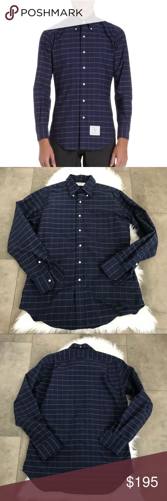 {thom Browne} navy windowpane oxford button down! Thom Browne navy windowpane button down oxford shirt! Colors are navy white and red. Size 4 or XL. Pre love and in great condition. Retails for $425. Excellent quality and structure, doesn't wrinkle. 100 % Cotton. Length is 33 in. Pit to pit is 23 in. I have another thom Browne oxford available for sale. Same size. Bundle and save! Thom Browne Shirts Dress Shirts
