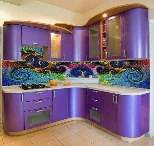 Now I love purple, but I wouldn't have purple cabinets. However, that backslash is gorgeous!