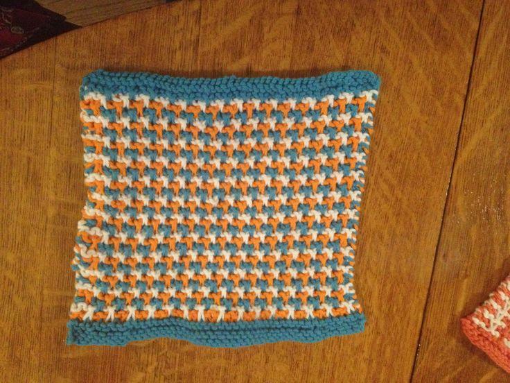 Turquoise, white & orange triple L tweed stitch face cloth