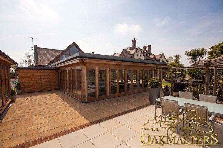 Oak pool house with low profile flat roof - Oakmasters - Oak framed pool construction