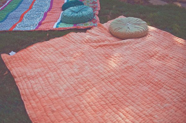 picnic blankets with a few butt-cushions for comfiness!