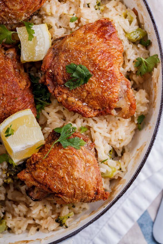 Crispy, golden chicken thighs on easy, cheesy broccoli rice is a great tasty weeknight meal. simply-delicious-food.com