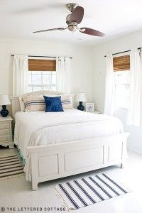 white curtains, bamboo shades, white walls w/splash of blue & wood fan ... ideas for mom's lake house
